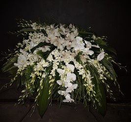 Tropical white casket spray from Flower Works II, your Medford area florist