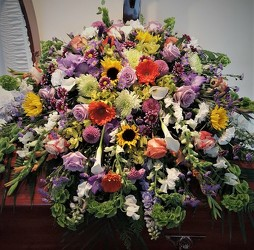 Masculine spring casket spray from Flower Works II, your Medford area florist